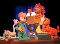 Christian Beltran as the narrator.  Photo courtesy of The Puppet Co.