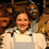 Dorothy (Clare Peyton) surrounded by Lion (B. Thomas Rinaldi), Tin Man (Derek Cooper) and Scarecrow (Kelsey Painter).