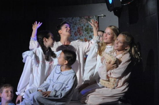 Katie Keyser as Maria with the Von Trapp Children. Photo by Stan Barouh.